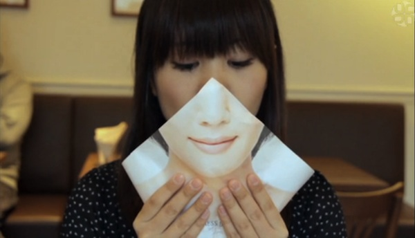 napkin held over mouth shows closed lips