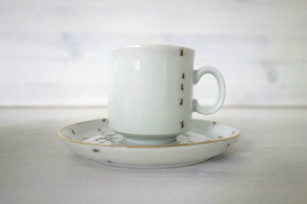 porcelain-dishes-covered-in-painted-ants