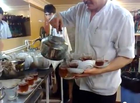 epic tea pouring man