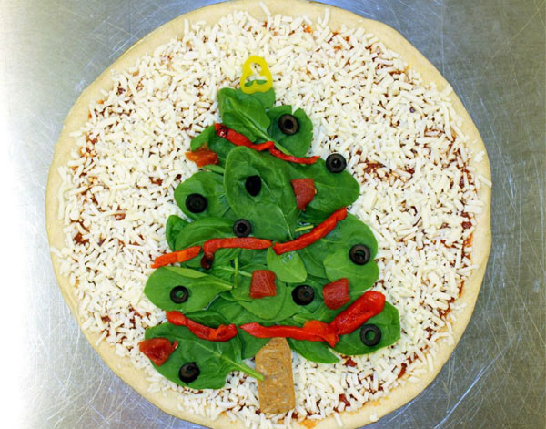 A Domino's Pizza With a Christmas Tree Topping