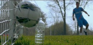 Klaas-Jan Huntelaar Kicks a ball toward a plastic bottle.