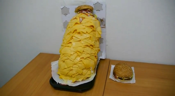 Whopper with 1000 slices of cheese next to regular whopper